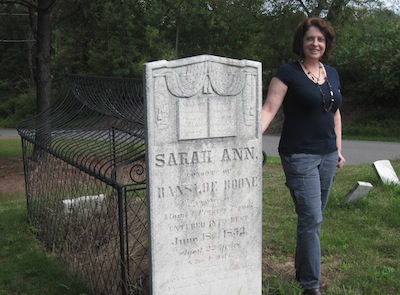 Dianne Salerni at the real caged grave of Sarah Ann Boone. Photo credit: Robert Salerni