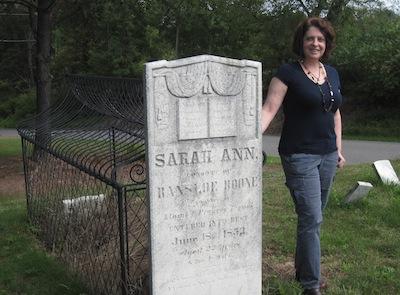 Dianne Salerni at the real caged grave of Sarah Ann Boone. Photo credit: Robert Salerni