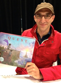 Aaron Becker holding Quest, the sequel to his Caldecott Honoree Journey.