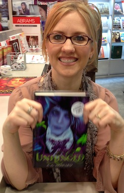 A. G. Howard with a shiny copy of Unhinged.