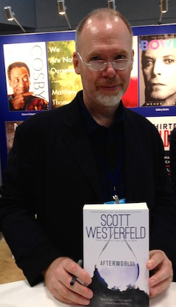 Scott Westerfeld with his forthcoming title Afterworlds.